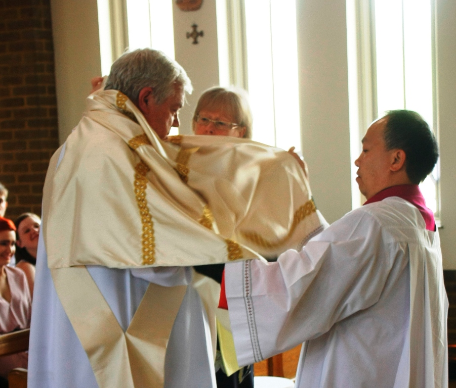 The Ordination of Nicholas StJohn to the Permanent Diaconate. The Vesting in the Stole and Dalmatic.